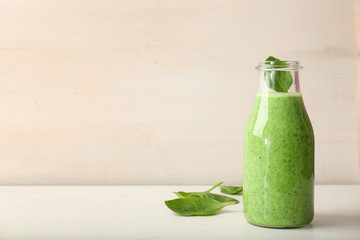 Bottle with delicious detox smoothie on table