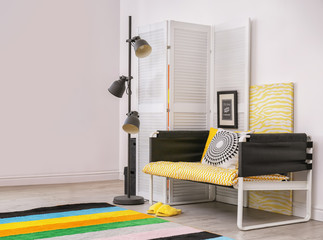 Elegant living room interior with comfortable sofa. Home design in rainbow colors