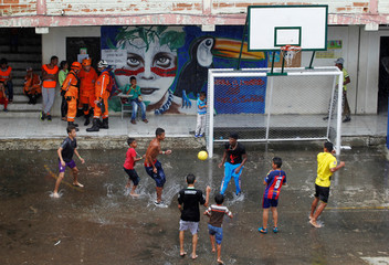 People play with a ball in a school used as a shelter after the Colombian government ordered the evacuation of residents living along the Cauca river, as construction problems at a hydroelectric dam prompted fears of massive flooding, in Valdivia