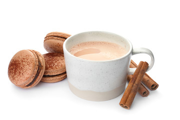 Mug with delicious hot cocoa drink and macarons on white background
