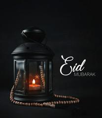 Eid Mubarak Greeting Typography. Ramadan Candle Lantern with Wooden Prayer Beads