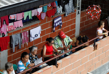 People look on in school used as a shelter after the Colombian government ordered the evacuation of residents living along the Cauca river