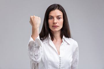 focus on the FIST of a stern woman