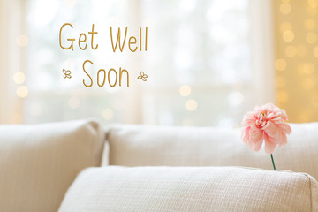 Get Well message with a flower in a bright interior room sofa