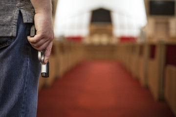 Church Shoots - A man carring a gun inside a church building - To harm or to protect? Fotomurales