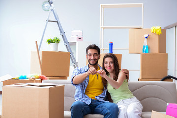 Young pair moving in to new apartment under mortgage