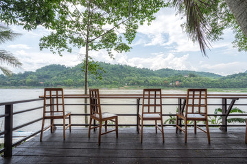 Empty chair for a rest to see a view of the Mekong River, Laos, mountain and nice sky.