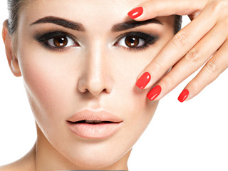 woman with red nails and brown makeup.
