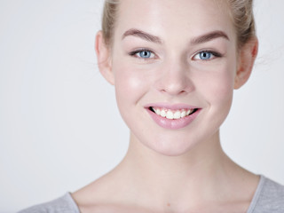 Portrait of a  beautiful young smiling  girl.