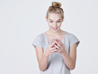 Portrait of a surprised woman with mobile phone