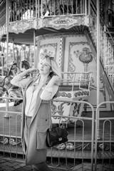 Photo sur Plexiglas Imagination Nice beautiful fashionable woman in an amusement park. Pretty , middle age lady having fun at an amusement park. Joy in adult life