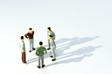 Business leadership, Teamwork power and confidence concept. Miniature people businessman small...