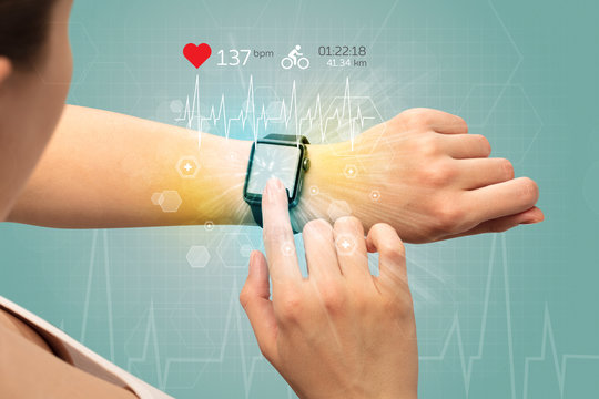 Hand with smartwatch and cycling concept nearby.