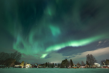 north light aurora on night sky at swedish countryside, north of country, village
