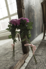 Pink flowers are reflected in the mirror