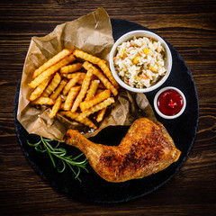 Roast chicken leg with chips and vegetables