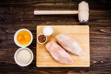 Raw chicken fillet on cutting board