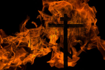 Fire cross in black background