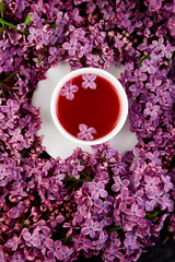 Cup of tea and bouquet  lilac