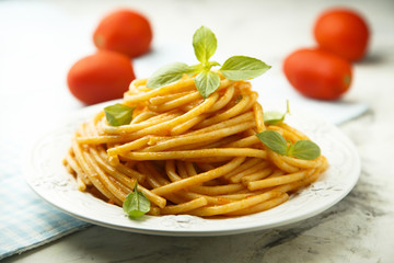 Pasta with tomato sauce and fresh basil