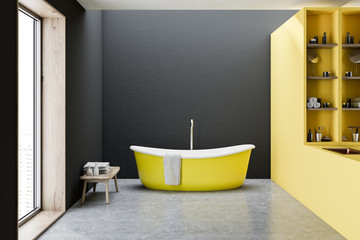 Yellow bathtub, black walls