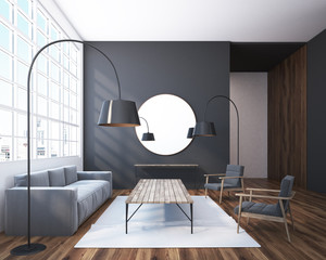 Gray living room with a round mirror