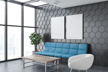 Gray living room corner with posters