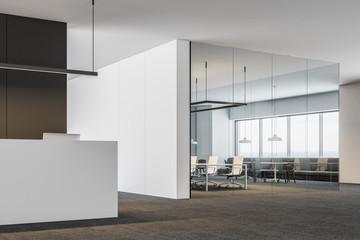 Office lounge with reception desk, meeting room
