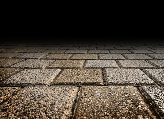 Rough stone block footpath floor texture perspective to black background for display or montage of product,Mock up template for your design