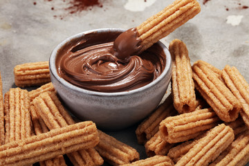 Wall Mural - Traditional Spanish dessert churros with sugar and chocolate