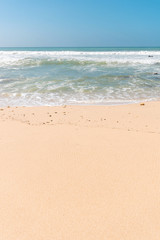 Fototapete - Tropical beach background with soft wave, white sand and blue sky