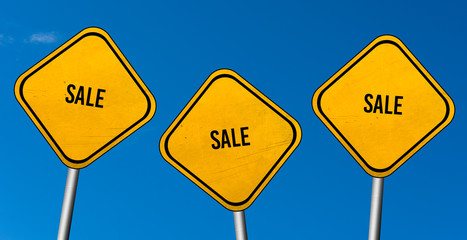 Sale - yellow sign with blue sky