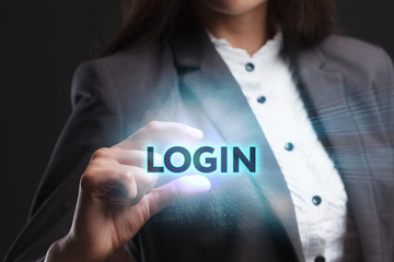 The concept of business, technology, the Internet and the network. A young entrepreneur working on a virtual screen of the future and sees the inscription: Login