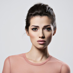 Portrait of an young beautiful  woman with  smoky eyes makeup.