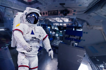 Astronaut pressure suit in a space shuttle cockpit ( NASA image not used )