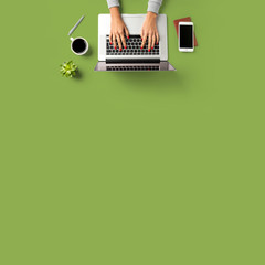 Woman working on laptop. Office desktop with copy space