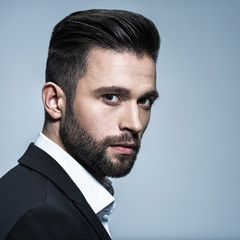 Photo sur Plexiglas Salon de coiffure Handsome man in black suit with white shirt