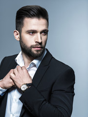Handsome man in black suit with white shirt