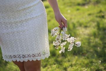 girl short white dress cherry branch flowers