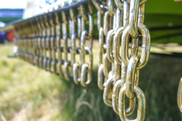 Iron chain on an agricultural trailer