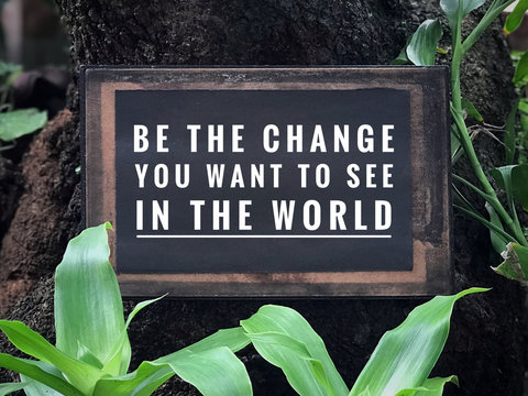 Motivational and inspirational quote - Be the change you want to see in the world. With vintage styled background.