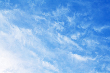 White feather clouds in bright azure sky (background)
