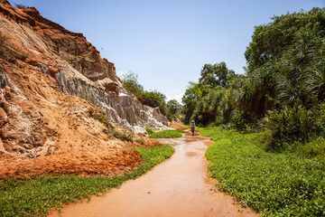 PHAN THIET, BINH THUAN, VIETNAM, May 7th, 2018: Fairy Stream Canyon Red river between rocks and jungle Mui Ne Vietnam. Red canyon near Mui Ne, southern Vietnam