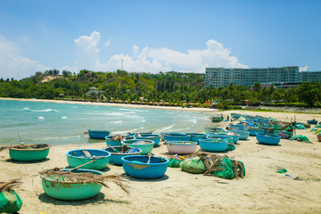 Typical fishing boats on the beach Mui Ne, Binh Thuan, Vietnam;