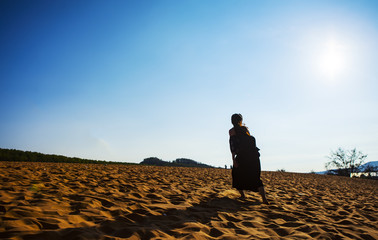 PHAN THIET, BINH THUAN, VIETNAM, May 7th, 2018: Red Sand Dunes and Sky near Mui Ne, Vietnam.