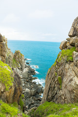 Pristine sea with rocky cliff at Dai Lanh cape point, Mui Dien, Phu Yen province, easternmost of Viet nam