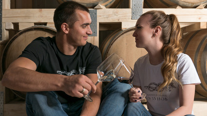 man and girl tasting wine winery