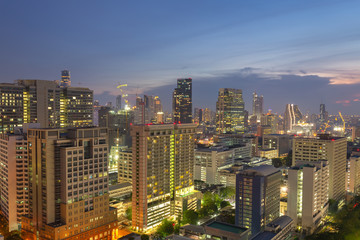 Night cityscape view of Bangkok modern office business building in business zone at Bangkok,Thailand. Bangkok is the capital of Thailand and also the most populated city in Thailand.