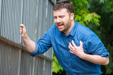 Man feeling chest pain and heart attack symptom