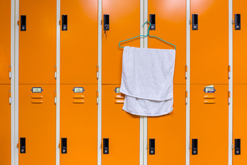 Towel hanging on locker in sport center.